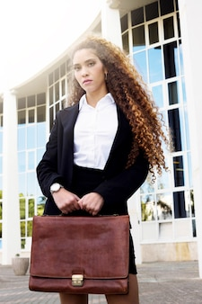 Modern businesswoman with bag