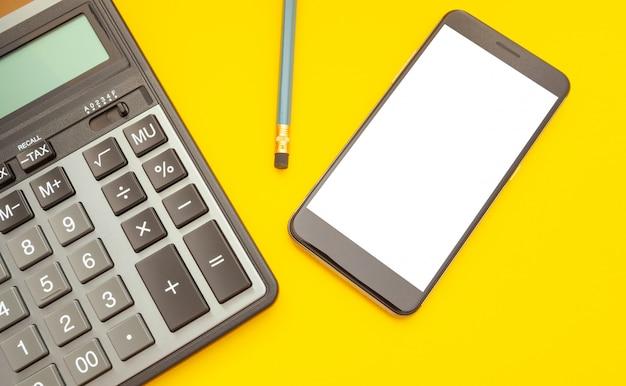 Modern calculator on yellow