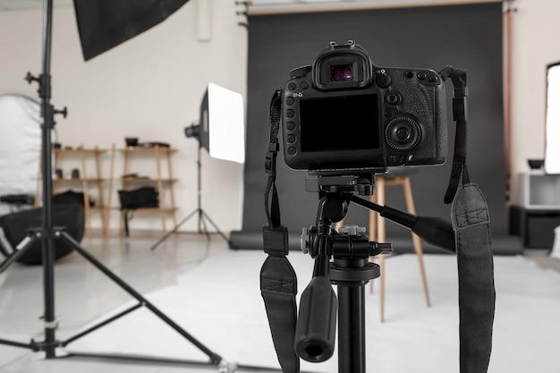 Modern camera in professional photo studio
