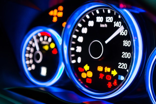 Modern car instrument panel dashboard with blue illuminated display, rev up.