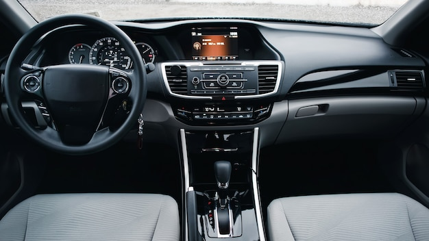 Modern car interior. steering wheel, shift lever and dashboard. detail of modern car interior. automatic gear stick.