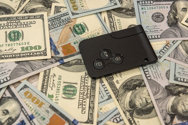 Modern car key with us dollar, sale or rent concept