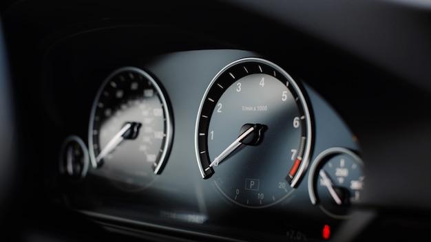 Modern car miles speedometer close up