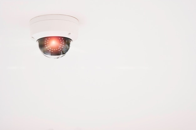Modern of cctv camera for monitoring surveillance and security on the white ceiling.
