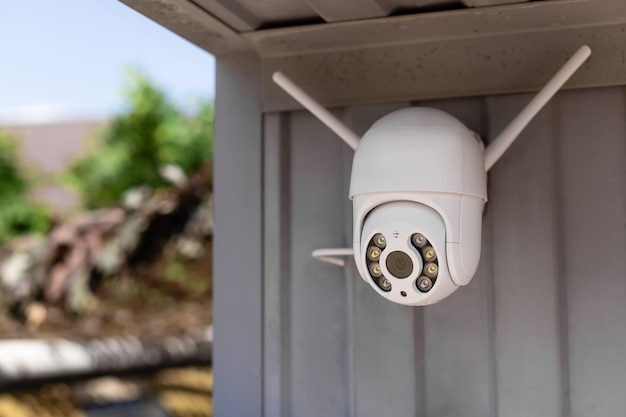 Modern cctv wifi surveillance camera installed on the garage for home security system