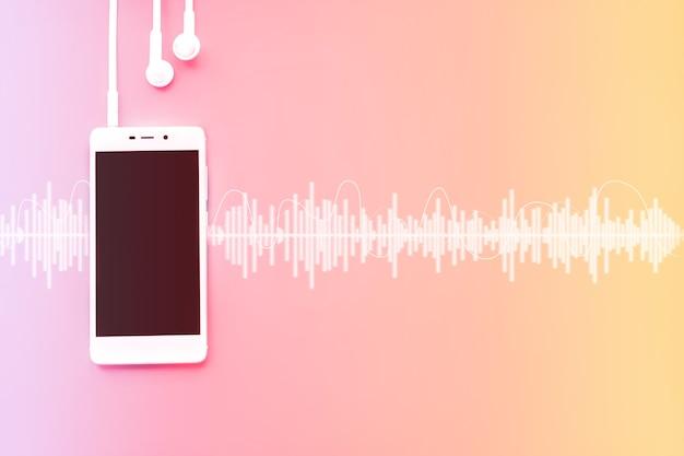 오디오 트랙이 있는 그라데이션 배경의 현대적인 셀 흰색 전화 및 헤드폰 템플릿입니다. 음악 개념입니다.