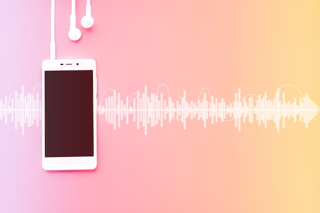 Modern cell white phone and headphones template on gradient background with audio track. music concept.