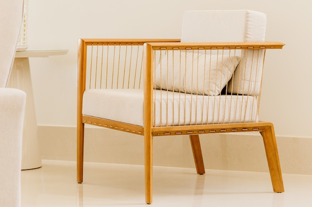 Modern chair with white cushions in a white room