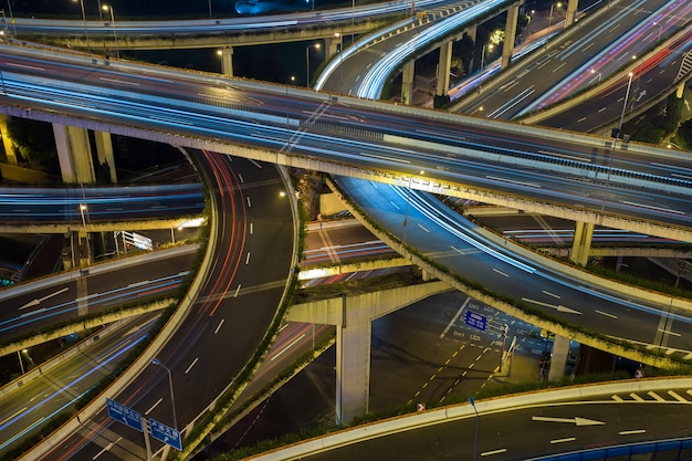 Modern city traffic road at night, transport junction