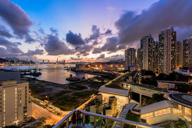 Modern city with houses and buildings during the sunset