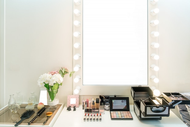 Modern closet room with make-up vanity table, mirror