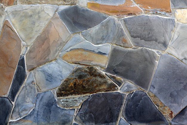Modern colorful slate stone wall texture for background and design art work.