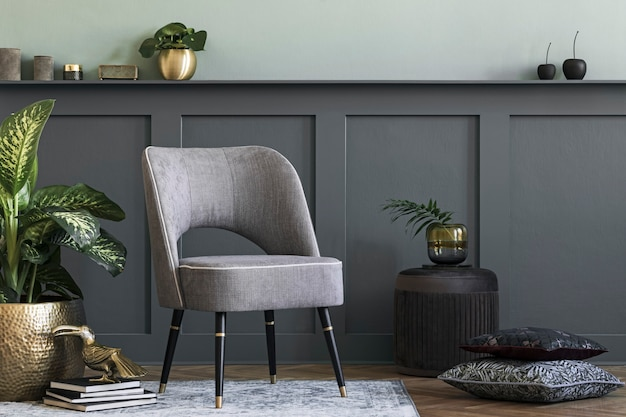 Modern composition of living room with design gray armchair, furniture, gold pot with beautiful plant and elegant personal accessories. gray wall panelling with shelf. stylish home staging.