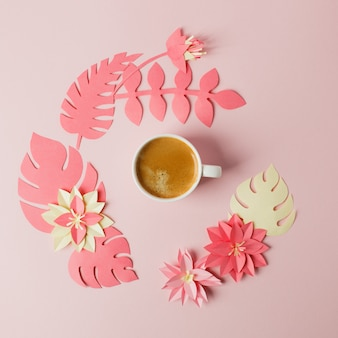 Modern concept of romantic morning breakfast - cup of coffee espresso and origami papercraft flowers