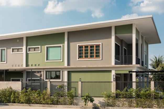 Modern contemporary house exterior view with blue sky.