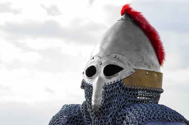 Modern copy of antique metal knight helmet with aventail. historical medieval costume detail