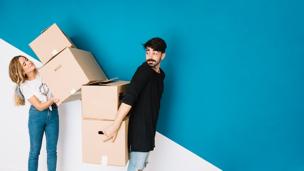 Modern couple moving to new flat