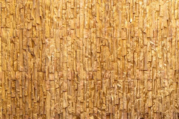 현대 금이 갈색 주황색 벽돌은 배경에 대한 야외 기분이 고급스러운 클래식 벽에 배열됩니다.