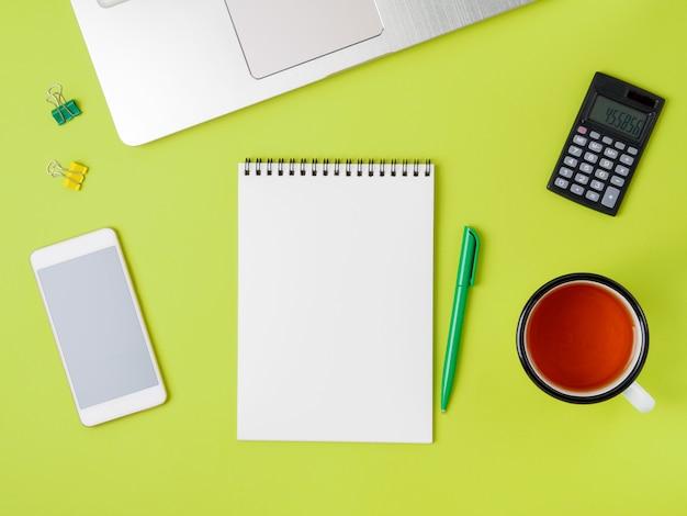Modern creative bright green office desk  laptop, s