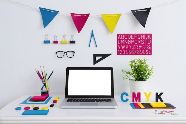 Modern creative workspace of a graphic designer with cmyk colors