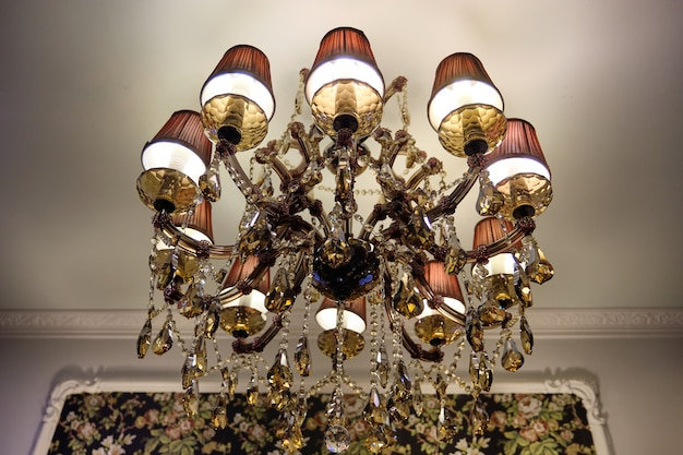 Modern crystal chandelier. gold designer luxury chandelier, close-up. expensive design and interior of the apartment, living room.