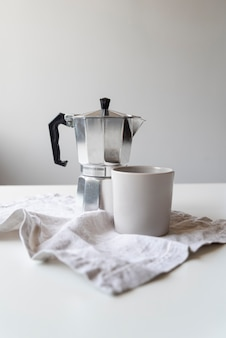 Modern design of coffee machine and cup