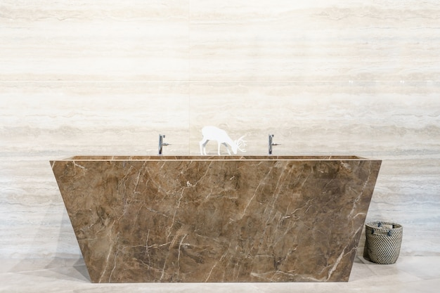 Modern design home with faucet   bathtub, marble sink and wall in a bathroom