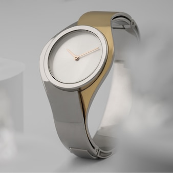Modern design silver and gold hand watch front view on white background