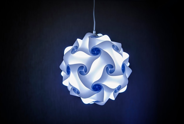 Modern designer lamp in blue light
