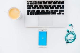 Modern desk with twitter app