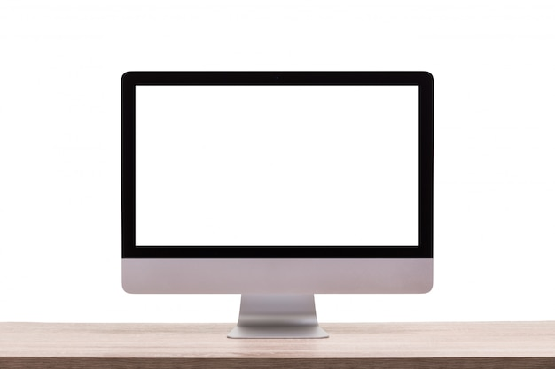 Modern desktop computer on wooden table.. blank screen for graphics display montage