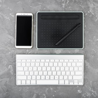 Modern digital devices on slate background