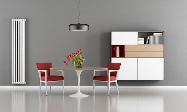 Современная столовая с круглым столом, стулом и буфетом Premium Фотографии