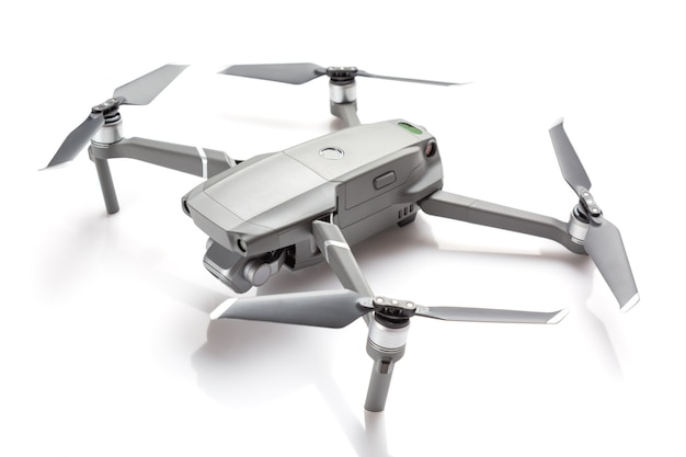 Modern drone quadcopter with a camera isolated on white background.
