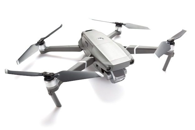 Modern drone quadcopter with a camera isolated on white.