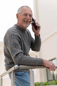 Modern elderly man outdoors