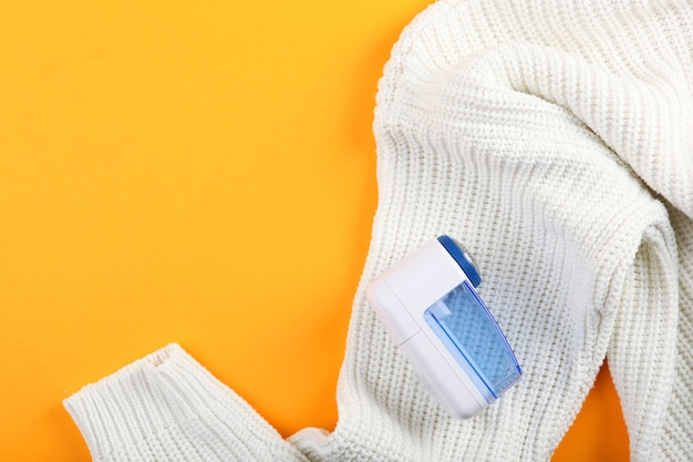 Modern electric fabric shaver and wool sweater