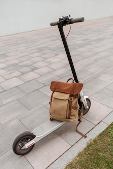Modern electric scooter with a backpack