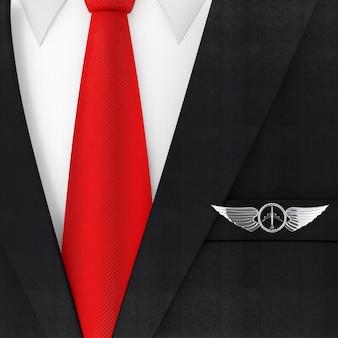赤いネクタイとシルバーのパイロットの翼のエンブレム、バッジまたはロゴシンボルの極端なクローズアップを備えたモダンでエレガントな男性のスーツ。 3dレンダリング
