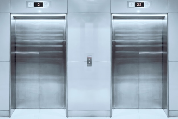 Modern elevator with closed doors in lobby