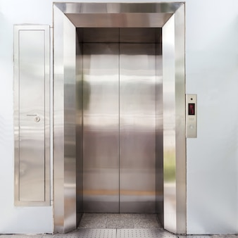 Modern elevator with closed metal doors.