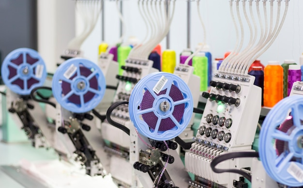 Modern embroidery machine with a device for sewing sequins and colored threads in production.