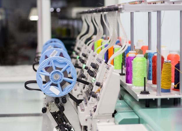 Modern embroidery machine with a device for sewing sequins and colored threads.