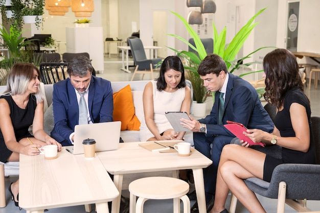Modern employees working together in office