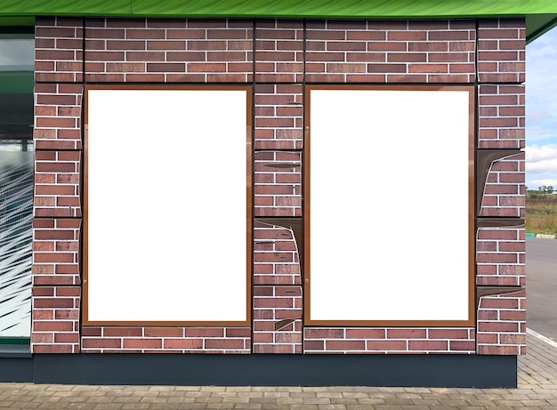 Modern empty blank advertising billboards banners on a wall in a city outdoors. mockup for your advertising project.