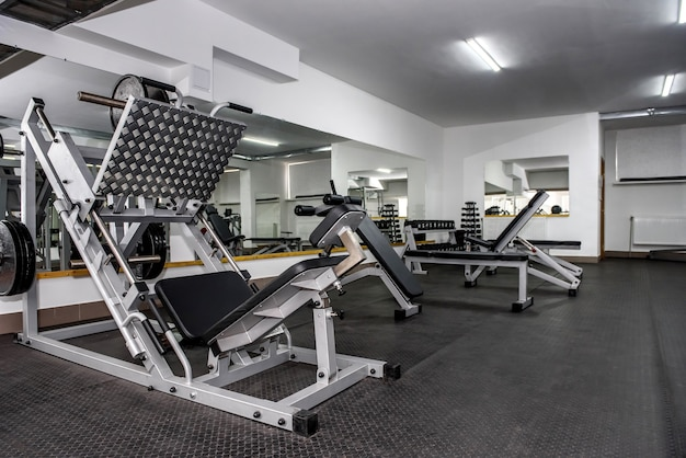 Modern and empty gym interior with equipment