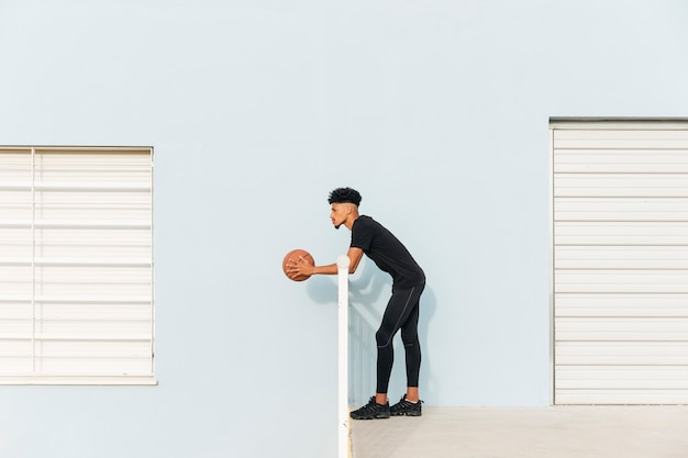 Modern ethnic standing with basketball