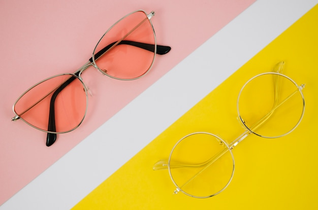 Modern eyeglasses on colorful background