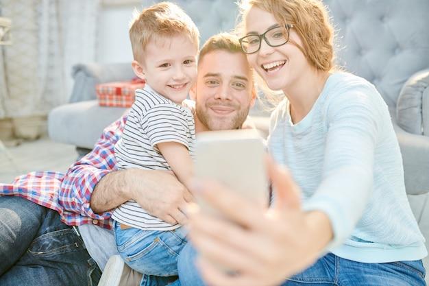 Modern family taking selfie at home