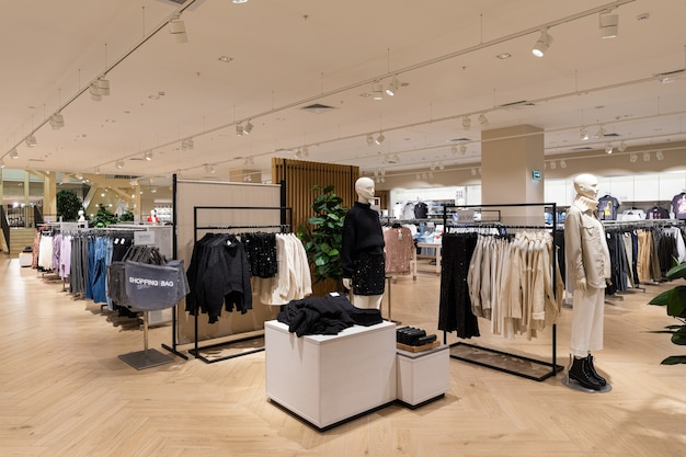Modern fashionable brand interior of men and women clothing shop store inside shopping center.